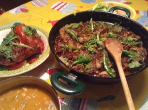 spicey mutton curry garnished with green chilies and parsley